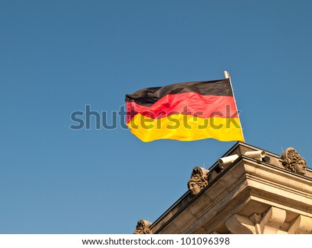 German Flag Flying over Reichstag Bundestag Building, Berlin Germany - stock photo