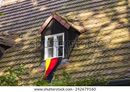 German flag of a fan of soccer - stock photo