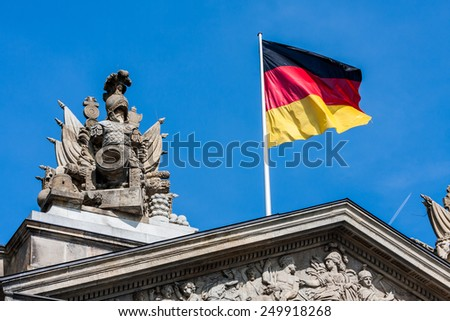 German Flag on parliament building - stock photo