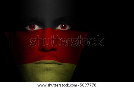 German flag painted/projected onto a man's face.