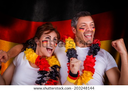 german flag soccer couple fans - stock photo