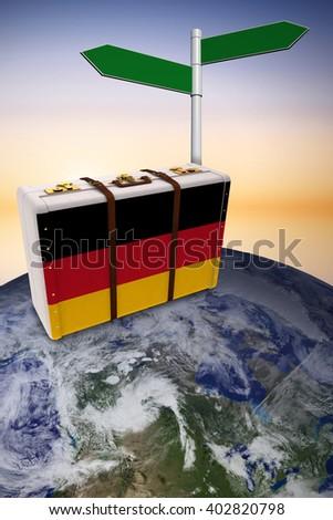 German flag suitcase against purple and orange sky - stock photo