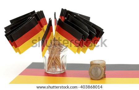 German flags and euro coins   - stock photo