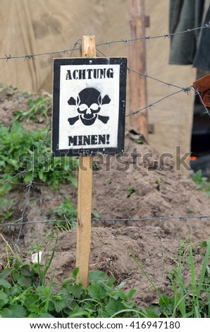 """German historical items of WWII.""""Achtung minen"""" sign. - stock photo"""