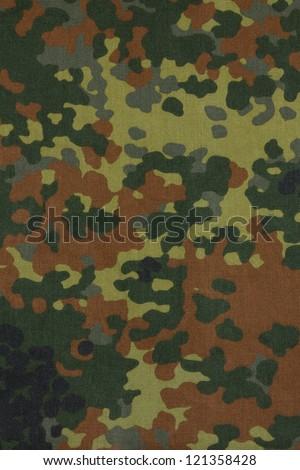 German military flecktarn camouflage fabric texture background - stock photo