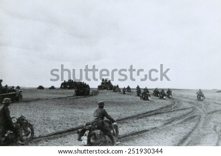 German motorcycle invasion troops in the Summer of 1941. Nazi photo caption identifies this as the Battle of Glosoff, Soviet Union (Russia), during World War 2. - stock photo