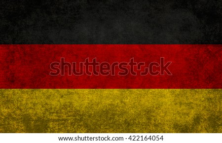 German National flag with a vintage retro or grunge textured treatment  - stock photo