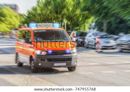 German Notarzt, Emergency Doctor Car From Fire Department Drives On A  Street To An Accident