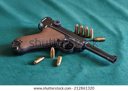 German Parabellum pistol model with cartridges - stock photo
