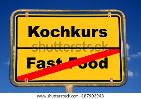 "German place-name sign with the German word ""Kochkurs"", translation: cooking course and the crossed out word ""Fast Food"""