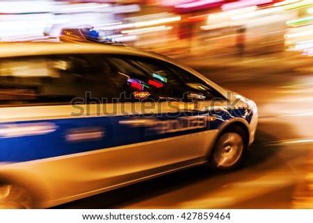 German police car at night in motion blur