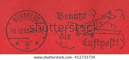 GERMAN REICH-CIRCA 1930:A stamp printed in German Reich,shows The postmark and stamp airmail on a red background,circa 1930 - stock photo