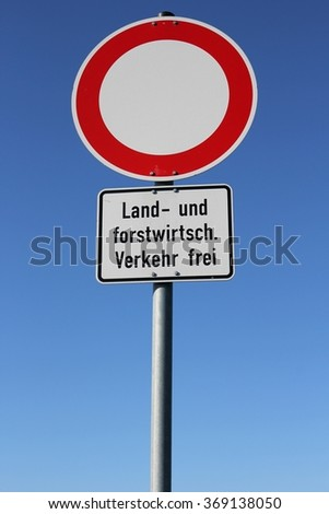 German road sign: no vehicles - agricultural and forestry vehicles allowed (translation: agricultural and forestry vehicles allowed)