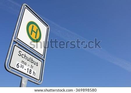 German road sign: stop for school buses at special times (translation: school bus) - stock photo