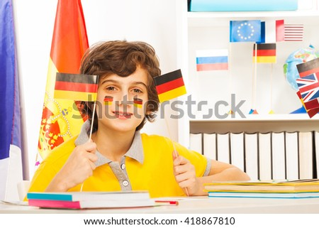 German schoolboy holding flags in his hands
