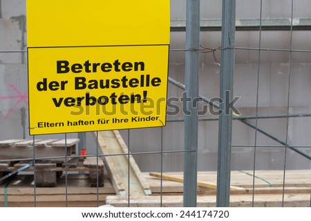 German sign that says No trespassing the construction site. Parents responsible for their children, copy space for text