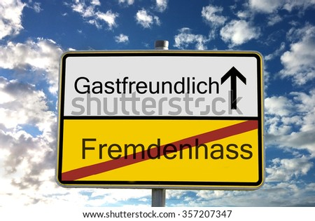 german sign translation: fremdenhass means xenophopia gastfreundlich means hospitable