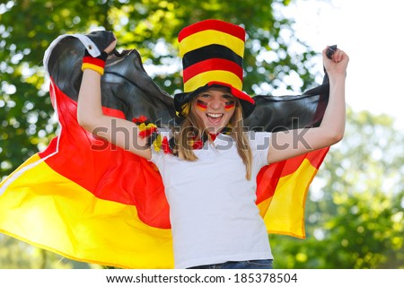 german soccer fan waving a flag outdoor - stock photo