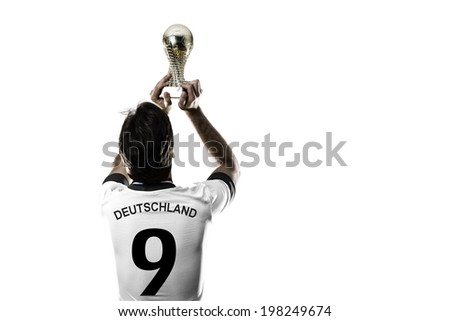 German soccer player, celebrating the championship with a trophy in his hand. On a white background. - stock photo