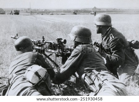 German soldiers fire a machine gun during the Nazi invasion of the Soviet Union (Russia). Summer 1941, during World War 2. - stock photo