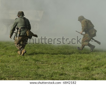german soldiers in the thick of battle - stock photo