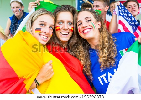 German, Spanish and Italian Supporters at Stadium - stock photo
