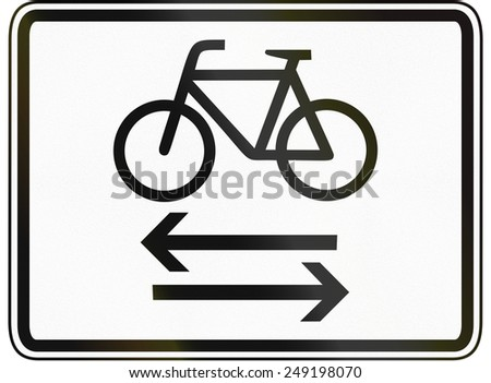 German traffic sign additional panel to specify the meaning of other signs: Cycle route crossing road both ways. - stock photo