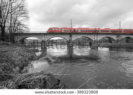 german train on a bridge in black and white - stock photo