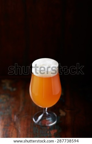 German Wheat Beer in a Glass - stock photo