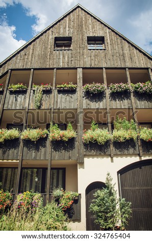 German wooden apartment house. Architectural theme. Vertical composition. - stock photo