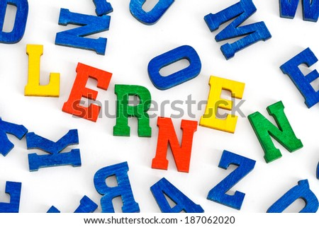 "German word ""Lernen"" (learn) made from and surrounded by wooden letters"