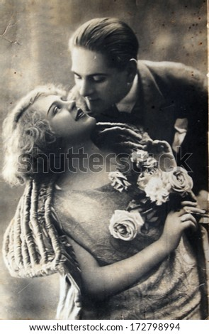 GERMANY - 1944: An antique photo shows couple in love - stock photo
