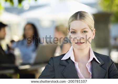 Germany, Bavaria, Upper Bavaria young businesswoman in beer garden