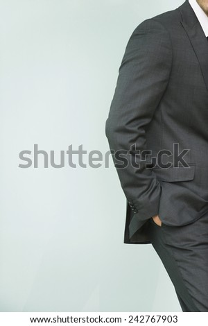Germany, businessman hand in pocket, middle section