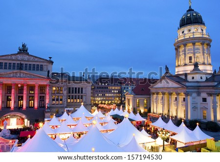 Germany/Capital Berlin. The very famous Christmas Market on the Gendarmenmarkt with the Schauspielhaus and the French Cathedral.  - stock photo