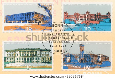 GERMANY - CIRCA 1998: A first day of issue postmark printed in Bonn, shows German State Parliament Buildings: Baden-Wurttemberg, Bavaria, Chamber of Deputies Berlin, Brandenburg, circa 1998 - stock photo