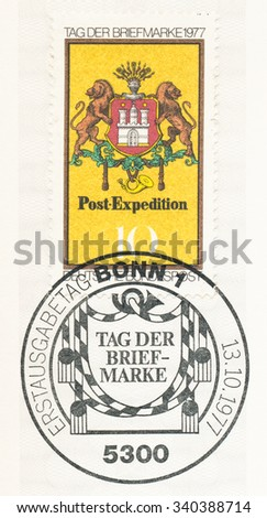 GERMANY - CIRCA 1977: A  first day of issue postmark printed in Germany, shows Arms of Hamburg, Post Emblem, c. 1861, circa 1977 - stock photo