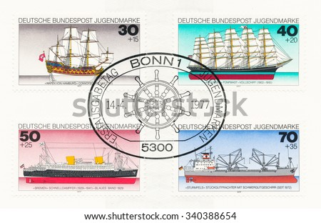 GERMANY - CIRCA 1977: A  first day of issue postmark printed in Germany, shows Historic Ships: Wapen von Hamburg 1730, Preussen  1902, Bremen 1929, Freighter Sturmfels 1972, helm, circa 1977 - stock photo