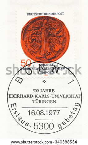 GERMANY - CIRCA 1977: A  first day of issue postmark printed in Germany, shows Jesus as Teacher, Great Seal of University, Tubingen University, 500th anniversary, circa 1977 - stock photo
