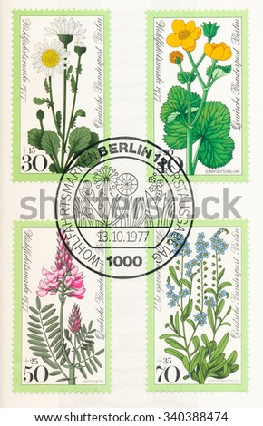 GERMANY - CIRCA 1977: A  first day of issue postmark printed in Germany, shows Meadow Flowers: Daisy, Cowslip, Sainfoin, Forget-me-not, circa 1977 - stock photo