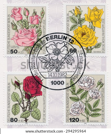 GERMANY - CIRCA 1982: A  first day of issue postmark printed in Germany, shows Roses: Floribunda grandiflora, Tea-rose hybrid, Floribunda, Miniature rose, circa 1982 - stock photo