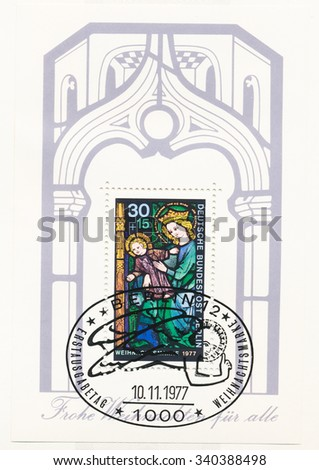 GERMANY - CIRCA 1977: A  first day of issue postmark printed in Germany, shows Souvenir Sheet: Virgin and Child, stained-glass window, Sacristy of St. Gereon Basilica, Cologne, circa 1977 - stock photo