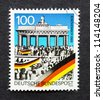 GERMANY - CIRCA 1990: a postage stamp printed in Germany commemorative of the first anniversary of the Berlin wall fall , circa 1990. - stock photo