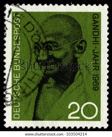 GERMANY CIRCA 1969: a postage stamp printed in Germany showing an image of Mahatma Gandhi, circa 1969. - stock photo