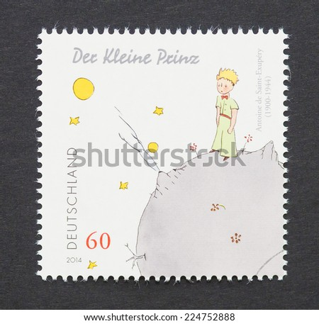 GERMANY - CIRCA 2014: a postage stamp printed in Germany showing an image of The Little Prince a novel of Antoine de Saint-Exupery, circa 2014.  - stock photo