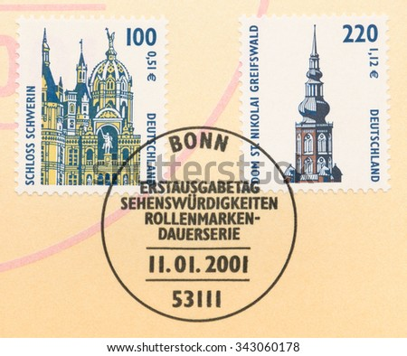 GERMANY - CIRCA 2001: A postage stamp printed in Germany, shows Schwerin Castle and St.  Nikolai Cathedral, Greifswald, circa 2001 - stock photo