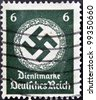 GERMANY - CIRCA 1943: A postage stamp printed in Germany shows the Swastika of the German Reich, circa 1943 - stock photo