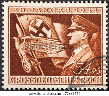 GERMANY - CIRCA 1944: A postage stamp printed in the Germany shows Adolf Hitler and symbols of Third Reich, circa 1944 - stock photo