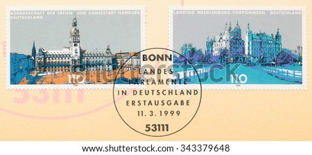GERMANY - CIRCA 1999: A postmark printed in Germany, shows Buildings State Parliaments,  Hamburg and Mecklenburg-Western Pomerania, circa 1999 - stock photo