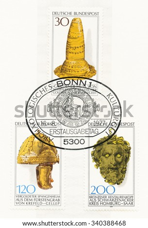 GERMANY - CIRCA 1977: A  postmark printed in Germany, shows Golden Hat, Schifferstadt, Bronze Age, Gilt helmet, from Princes Tomb, Krefeld-Gellep, Bronze Centaurs head, Schwarzenacker, circa 1977 - stock photo